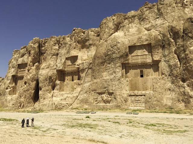 The site of Naqsh-e-Rostam with the royal tombs of Darius, Xerxes and Artaxerxes carved into the cliff.