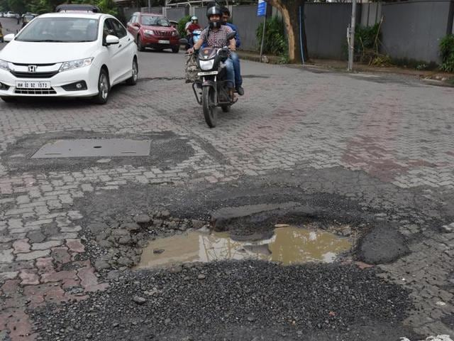 The potholes on a road at Goregaon on Thursday.