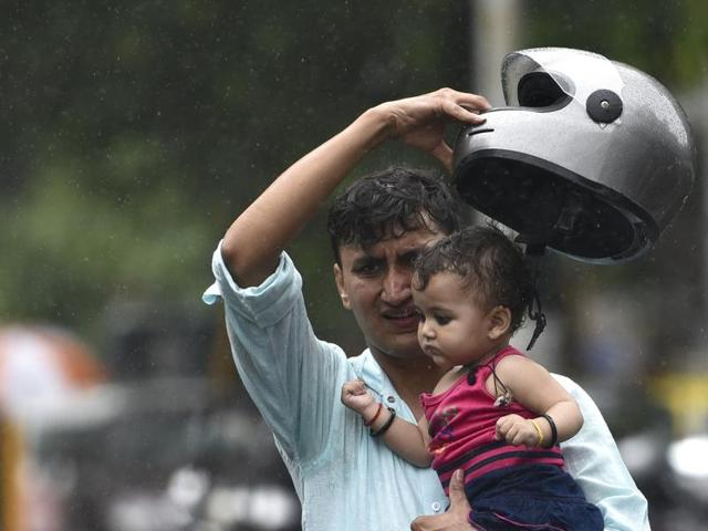 A woman enjoys the in Mumbai on Thursday. Arijit Sen/ Hindustan Times