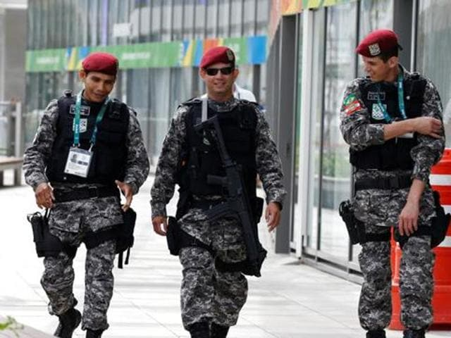 Brazilian Public-Safety National Force personnel patrol the 2016 Rio Olympics Park in Rio de Janeiro.