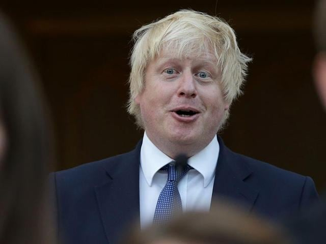 British Foreign Secretary Boris Johnson reacts as he sings the French national anthem during a reception at the French Ambassador's residence in London on July 14.
