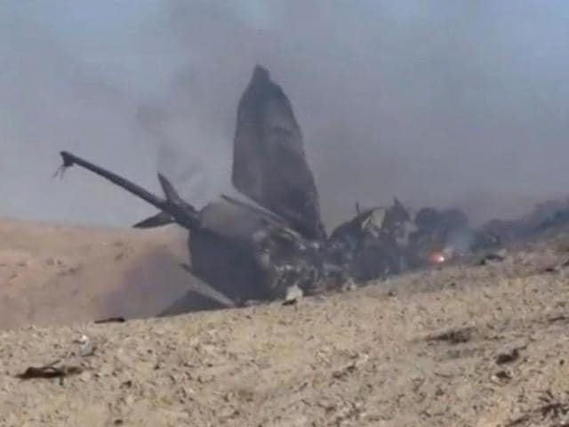 A still image taken on July 14, 2016 from a video posted on social media shows the wreckage of a Syrian jet that was brought down by Islamic State fighters near the eastern city of Deir Ezzor in Syria.
