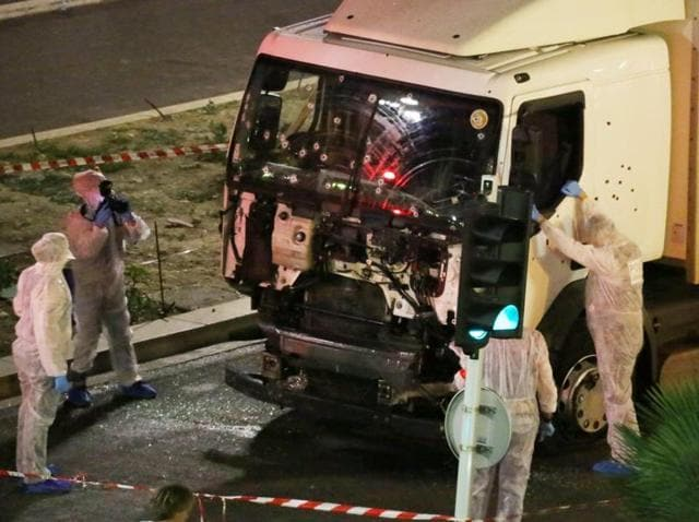 Authorities investigate a truck after it plowed through Bastille Day revelers in the French resort city of Nice on Thursday.