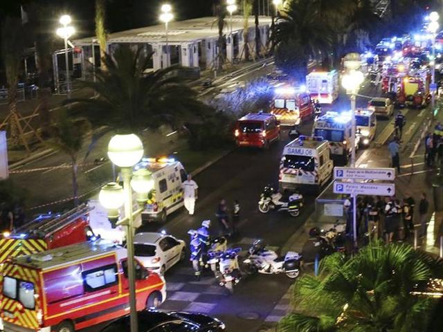 Police officers, firefighters and rescue workers at the site of an attack on the Promenade des Anglais on July 14, after a truck drove into a crowd during a fireworks display in Nice. The attack left 84 dead and scores injured during the celebrations that marked Bastille Day.