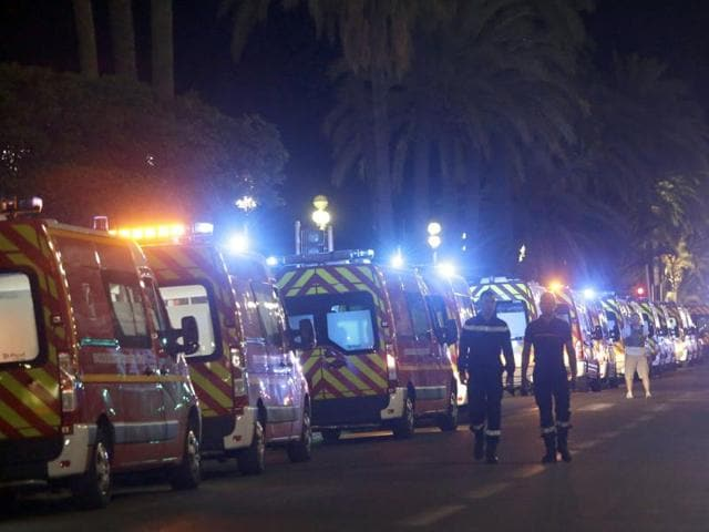 Ambulances line up near the scene of an attack after a truck drove on to the sidewalk and plowed through a crowd of revellers who had gathered to watch the fireworks in the French resort city of Nice.