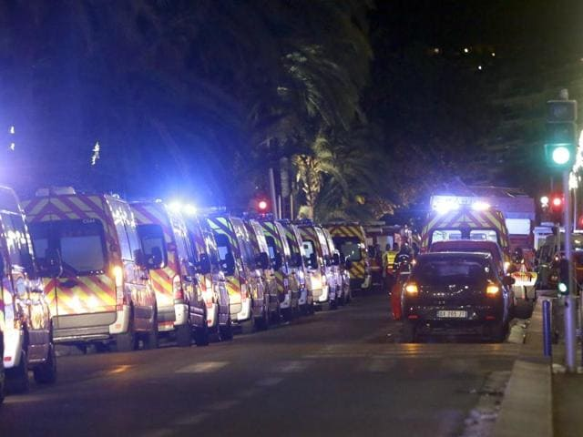 Ambulances line up near the scene of an attack after a truck drove on to the sidewalk and plowed through a crowd of revelers who'd gathered to watch the fireworks in the French resort city of Nice, southern France, Friday, July 15, 2016.