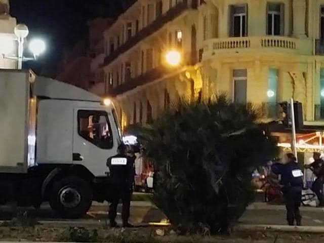 Police approach the driver's cab of a truck, in Nice, France, late Thursday July 14, 2016. The large truck plowed through revelers gathered for Bastille Day fireworks in Nice, killing at least 84 people and sending others fleeing into the sea as it bore down for more than a mile (2 Km) along the Riviera city's famed waterfront promenade.