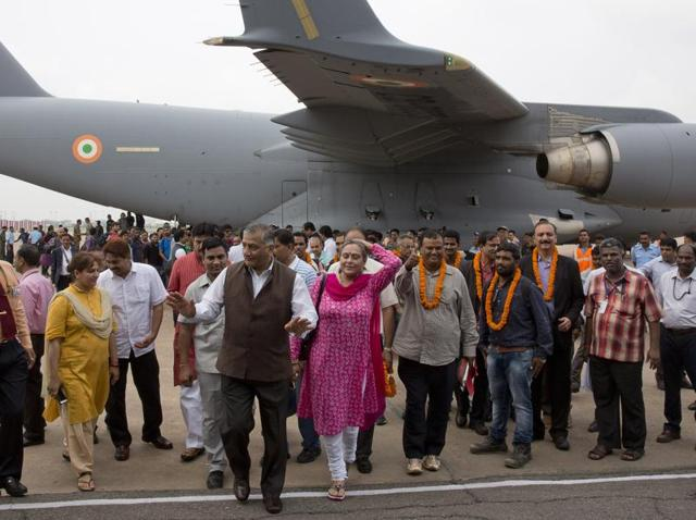 Indian citizens evacuated from war-torn South Sudan arrive at Palam airport in Delhi with junior foreign minister VK Singh.