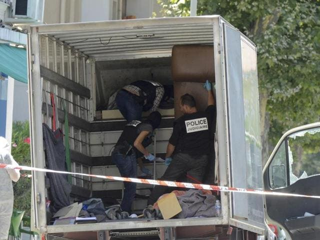 French investigating police conduct a search of inside a truck, the day after a heavy a truck ran into a crowd at high speed killing scores and injuring more who were celebrating the Bastille Day national holiday, in Nice, France, July 15, 2016.