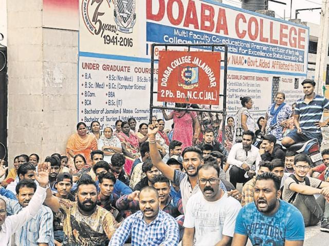 Parents and students belonging to scheduled caste and backward class categories protesting outside Doaba College in Jalandhar on Thursday.
