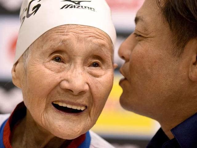 101-year-old Mieko Nagaoka swimming during the women's 400m freestyle race in the Japan Masters swimming competition.