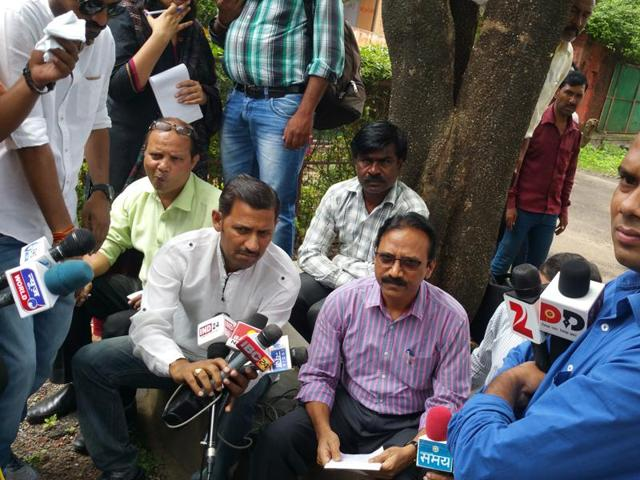 IAS officer Ramesh Thete addresses the media outside the IAS guesthouse in Char Imli area of Bhopal on Thursday.