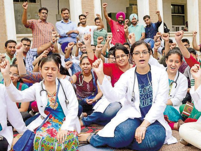 Members of Junior Doctors' Association protesting at Government Rajindra Hospital in Patiala on Thursday.