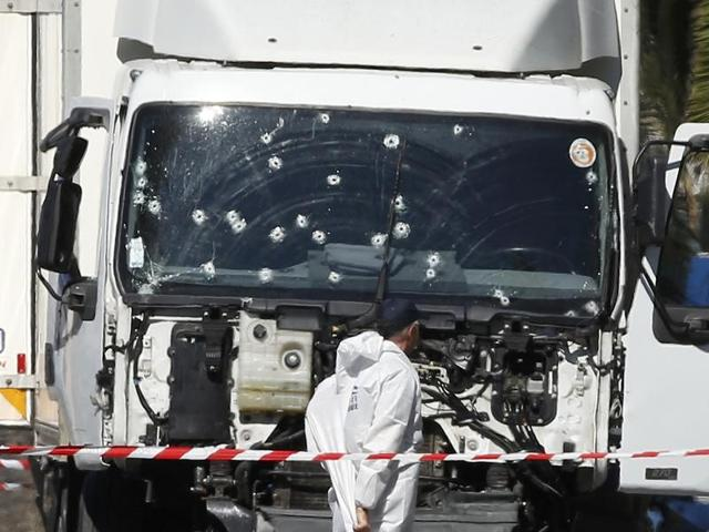Investigators continue at the scene near the heavy truck that ran into a crowd at high speed killing scores who were celebrating the Bastille Day in Nice.