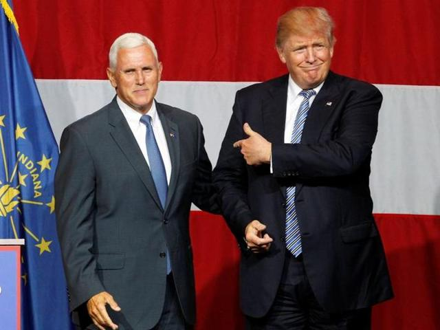 Presumptive Republican presidential nominee Donald Trump, right, named Indiana governor Mike Pence as his running mate on Friday.