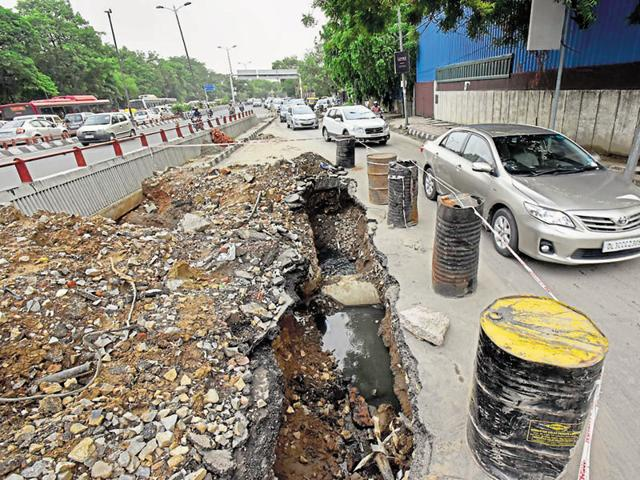 The caved-in service lane at outer Ring Road on Friday