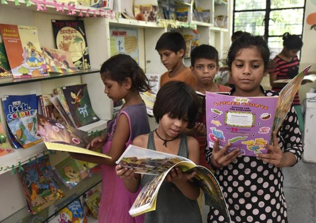 The library has hundreds of books on various subjects, including story books for children.