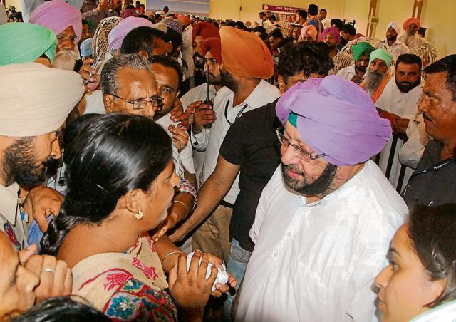 Punjab Congress chief Captain Amarinder Singh interacting with people during the 'Halke Vich Captain' programme at Nihal Singh Wala village in Moga on Thursday.