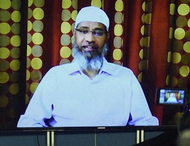 Islamic preacher Zakir Naik addresses the media through a video conference in Mumbai.