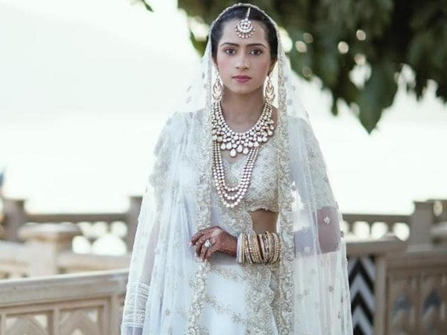 Designer Kresha Bajaj embroidered her love story on to her wedding outfit.