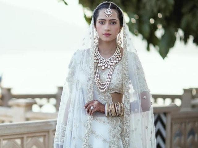 Designer Kresha Bajaj embroidered her love story on to her wedding outfit.