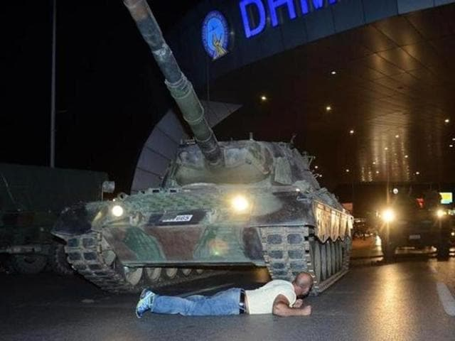 A man lies in front of a Turkish army tank at Ataturk airport in Istanbul. (Reuters)
