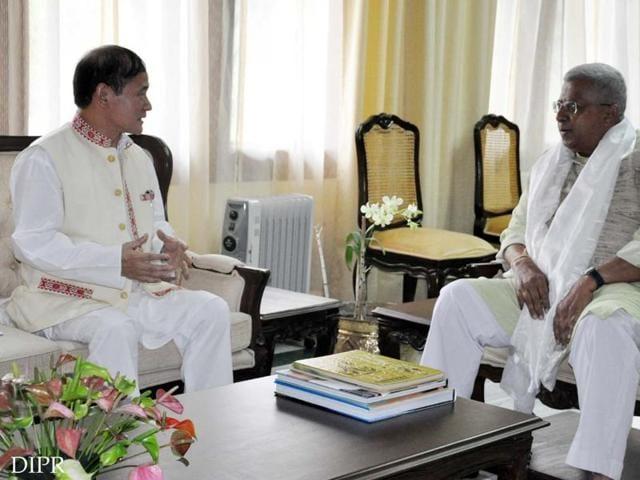 Arunachal CM Nabam Tuki (left) meets governor Tathagata Roy.