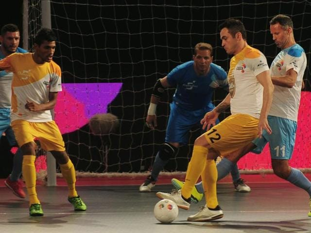 Alessandro Rosa Viera (second right), also known as Falcao, from the Chennai 5's plays against the Mumbai 5's during their Premier Futsal Football League match in Chennai.