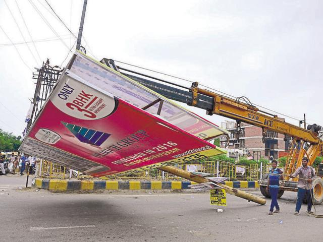 The drive was carried out after a roadside vendor had a narrow escape when a unipole got uprooted and crashed on his kiosk in Shakti Khand on Wednesday.