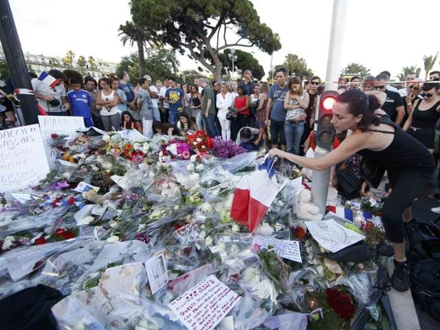 People pay tribute to victims a day after scores of Bastille Day revellers were killed on the Promenade des Anglais in Nice, France.