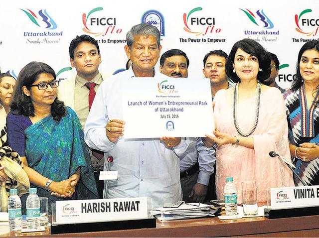 Chief minister Harish Rawat with the woman members of FICCI.