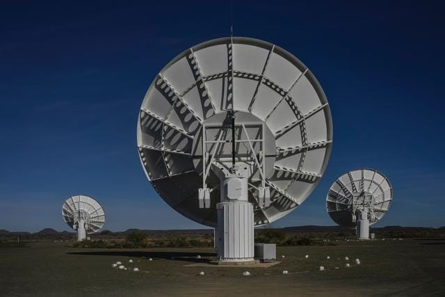 Part of the ensemble of dishes forming South Africa's MeerKAT radio telescope is seen in Carnarvon on July 16, 2016. Even operating at a quarter of its eventual capacity, South Africa's MeerKAT radio telescope showed off its phenomenal power on July 16, revealing 1,300 galaxies in a tiny corner of the universe where only 70 were known before.