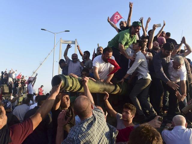 Supporters of Tukish President Tayyip Erdogan celebrate after soldiers involved in the coup surrendered on the Bosphorus Bridge in Istanbul.