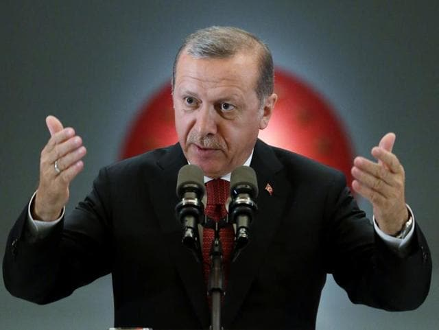 Turkey's President Recep Tayyip Erdogan addresses people gathered for a traditional
