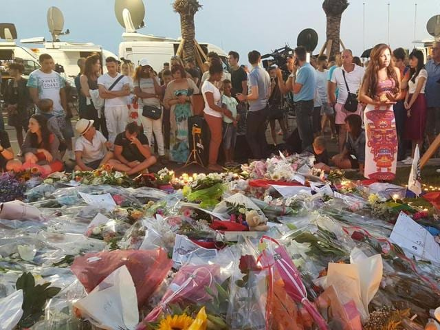 People mourn near the site of the truck attack in Nice that left 84 dead.
