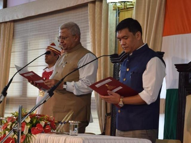 The governor administers the oath of office to Pema Khandu, who was sworn in as the Arunachal Pradesh chief minister on Sunday.