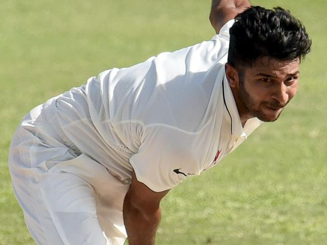 Indian cricketer Shardul Thakur delivers a ball during the final day of the three-day tour match.