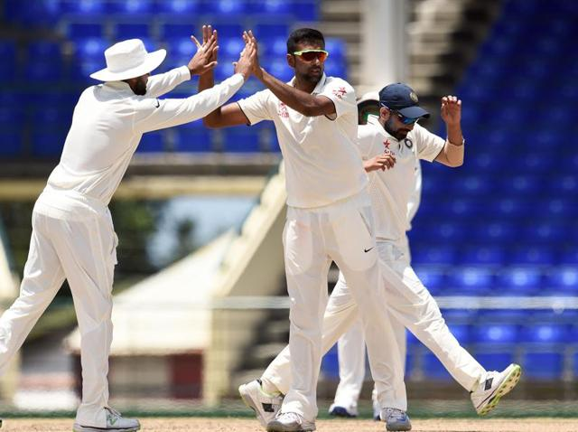 Indian cricketer Ravichandran Ashwin (L) celebrates dismissing WICB President's XI batman John Campbell.