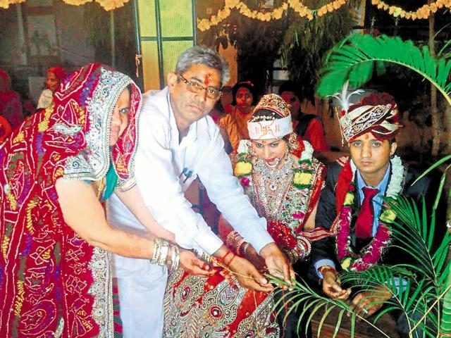 Nursery owner from Rajasthan's Jhunjhunu district, Hoshiyar Singh, gifts a tree to his daughter during her marriage.