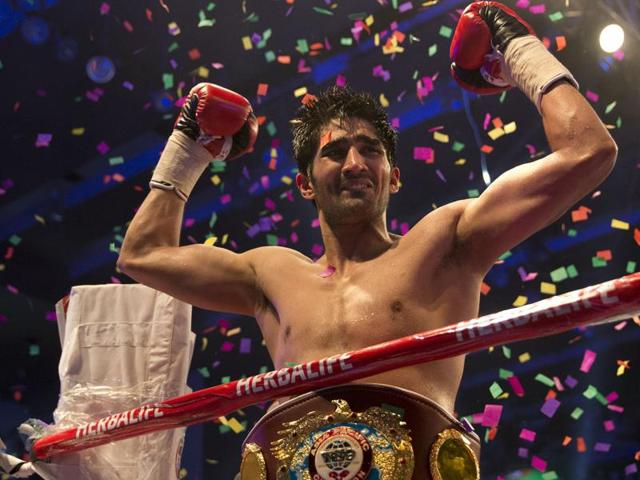 Indian boxer Vijender Singh (L)land a punch on his opponent, Australia's Kerry Hope, during the WBO Asia Pacific Super Middleweight Championship 'Title Fight' in New Delhi on July 16. Vijender won the title, a first for an Indian in the professional circuit.