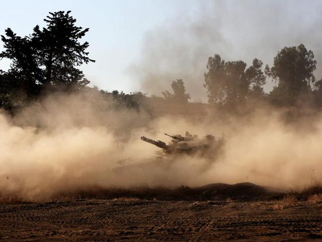 An Israeli soldier maneuvers a tank during a military exercise in the northern part of the Israeli-annexed Golan Heights near the border with Syria on June 23, 2016.