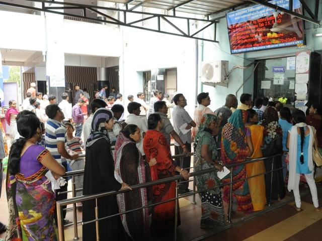 Patients queue outside JP hospital in Bhopal on Saturday. Government hospitals in Bhopal are tending to more than 300 patients, suffering from diarrhoea, everyday.