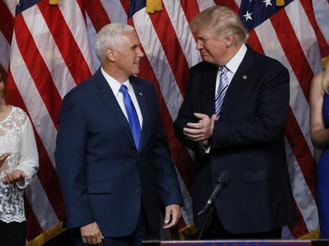 Republican US presidential candidate Donald Trump applauds introducing Indiana Governor Mike Pence (L) as his vice presidential running mate in New York City.