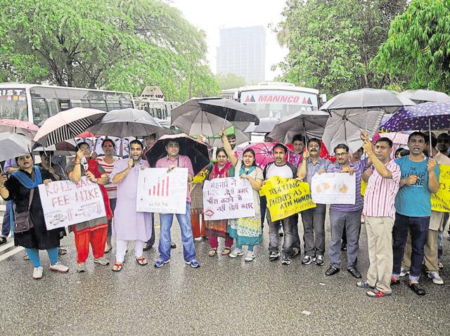 Unmindful of the downpour, parents protested against the fee hike outside Apeejay School in Sector 16A on Saturday.