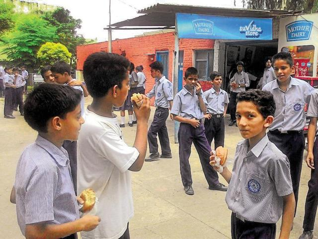Students having junk food at Government Model Senior Secondary School, Sector 16, Chandigarh, on Saturday.