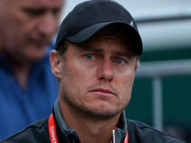 Australia's Lleyton Hewitt watches Australia's Bernard Tomic lose against France's Lucas Pouille.