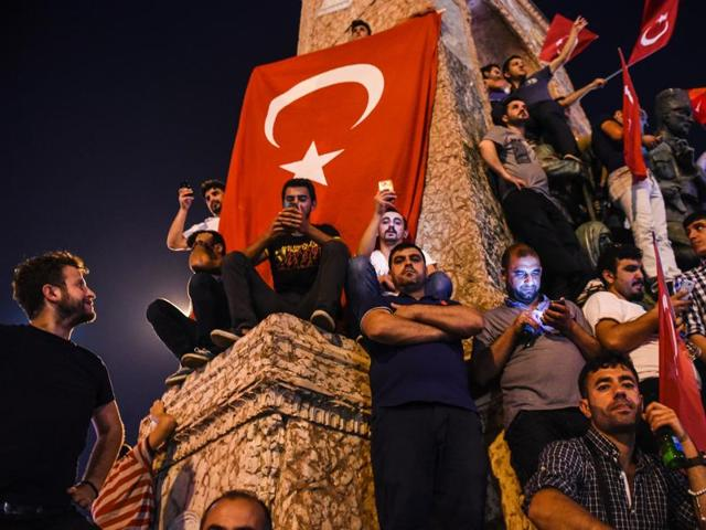 Pro-Erdogan supporters gather at Taksim square in Istanbul to support the government on July 16, 2016, following a failed coup attempt.