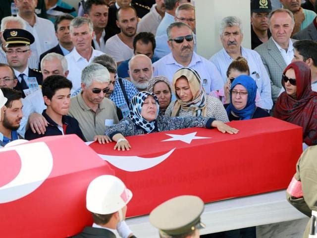 Relatives mourn over the coffin of Omer Cenkatar who was killed in a thwarted coup.