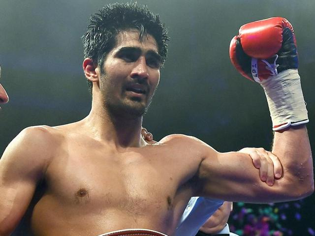 India's boxer Vijender Singh celebrates after defeating Australia's boxer Kerry Hope.