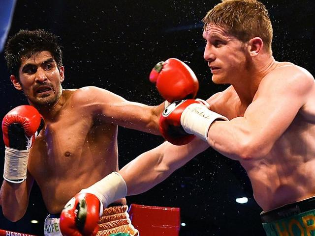 Indian boxer Vijender Singh reacts after winning WBO Asia Pacific Super Middleweight title.